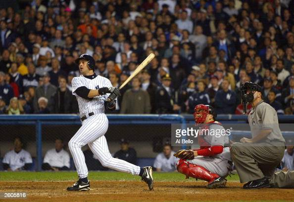 Aaron Boone of the New York Yankees hits the game winning home run in the bottom of the eleventh inning against the Boston Red Sox during game 7 of...