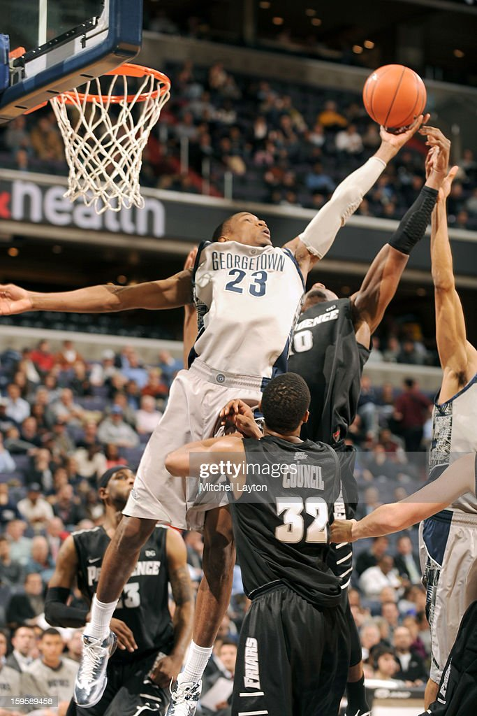 Aaron Bowen #23 of the Georgetown Hoyas pulls down a rebound during a college basketball game against the Providence Friars on January 16, 2013 at the Verizon Center in Washington, DC.