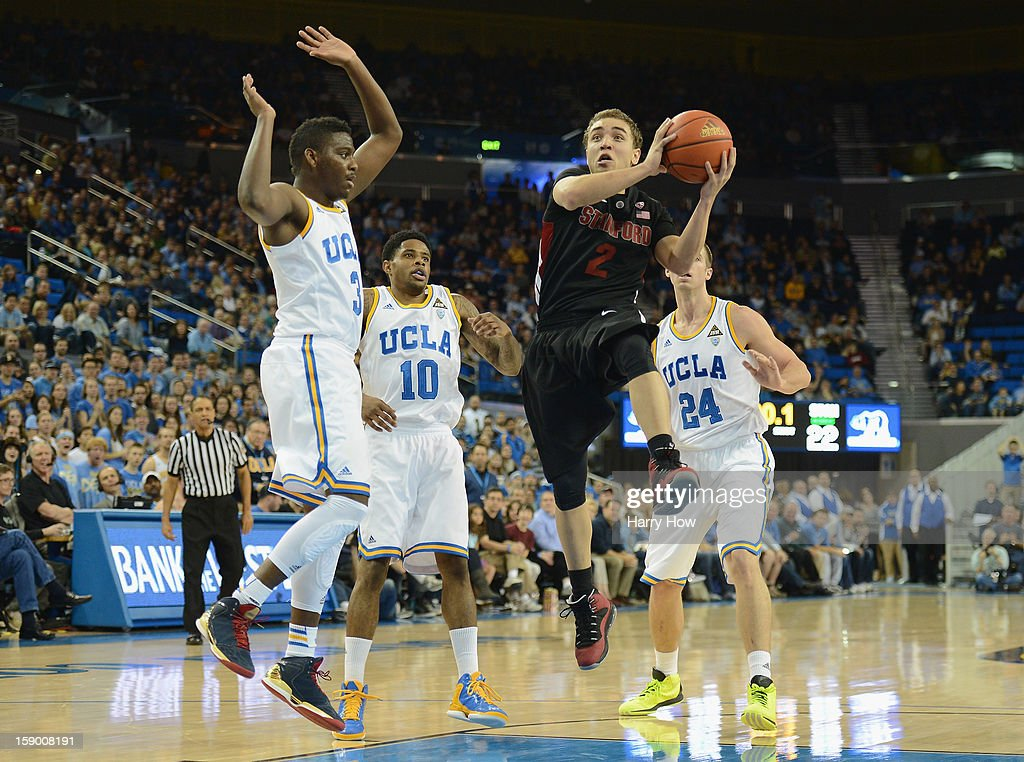 Aaron Bright #2 of the Stanford Cardinal drives to the basket in front of Jordan Adams #3, Larry Drew II #10 and Travis Wear #24 of the UCLA Bruins at Pauley Pavilion on January 5, 2013 in Los Angeles, California.