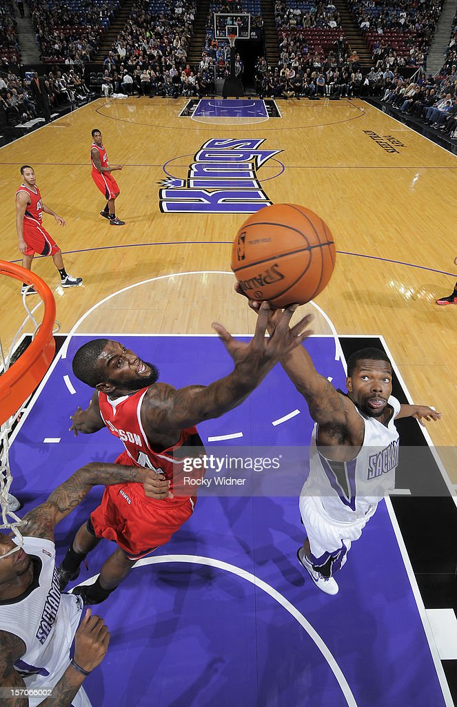 Aaron Brooks #3 and Ivan Johnson #44 of the Atlanta Hawks battle for the rebound on November 16, 2012 at Sleep Train Arena in Sacramento, California.