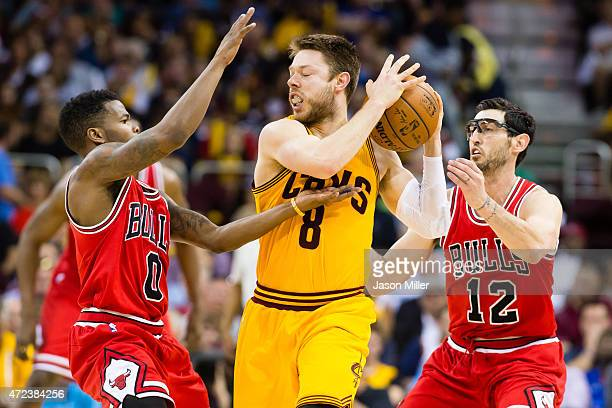 Aaron Brooks and Kirk Hinrich of the Chicago Bulls guard Matthew Dellavedova of the Cleveland Cavaliers in the second half during Game Two in the...