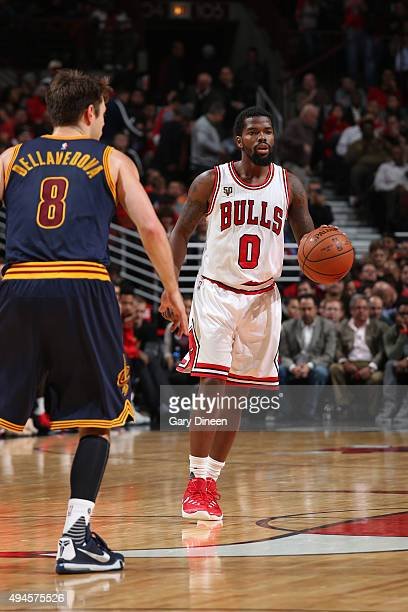Aaron Brooks of the Chicago Bulls brings the ball up court against Matthew Dellavedova of the Cleveland Cavaliers on October 27 2015 at the United...