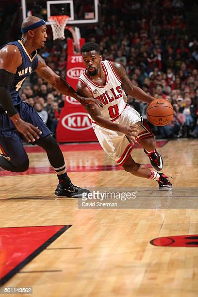 Aaron Brooks of the Chicago Bulls drives to the basket against the New Orleans Pelicans on December 12 2015 at the United Center in Chicago Illinois...