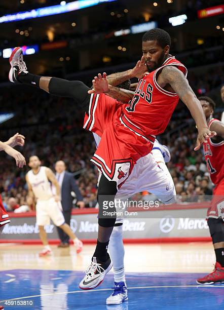 Aaron Brooks of the Chicago Bulls falls to the court after commiting a flagrand foul against Matt Barnes of the Los Angeles Clippers at Staples...