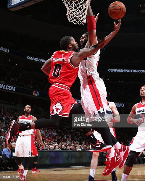 Aaron Brooks of the Chicago Bulls goes up for a shot against the Washington Wizards on December 12 2014 in Washington DC NOTE TO USER User expressly...