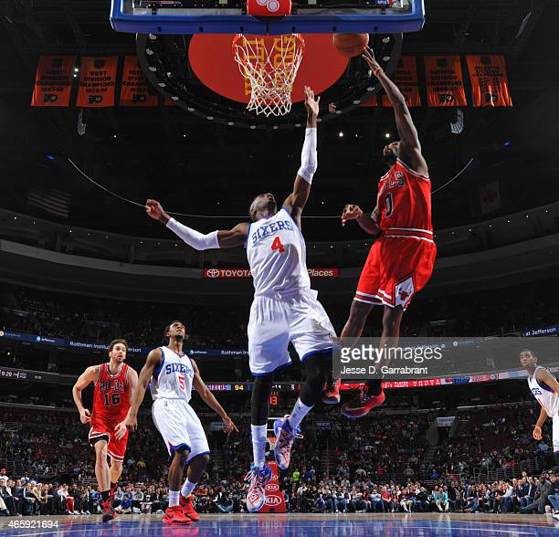 Aaron Brooks of the Chicago Bulls goes up for the layup against the Philadelphia 76ers at Wells Fargo Center on March 11 2015 in Philadelphia...