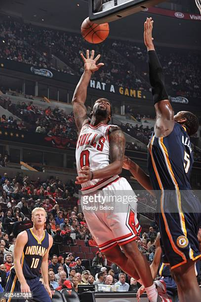 Aaron Brooks of the Chicago Bulls hooks the ball against Lavoy Allen of the Indiana Pacers during the preseason game on October 20 2015 at United...