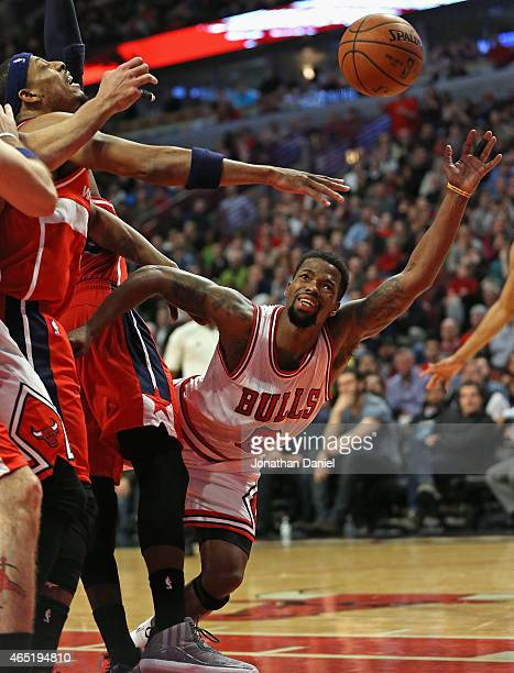 Aaron Brooks of the Chicago Bulls is fouled while shooting by Paul Pierce of the Washington Wizards at the United Center on March 3 2015 in Chicago...