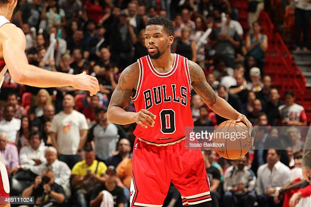 Aaron Brooks of the Chicago Bulls looks to move the ball against the Miami Heat during the game on April 9 2015 at AmericanAirlines Arena in Miami...
