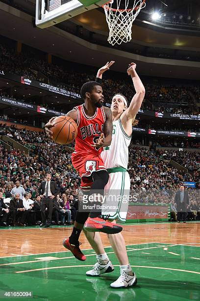 Aaron Brooks of the Chicago Bulls looks to pass against the Boston Celtics during the game on January 16 2015 at the TD Garden in Boston...