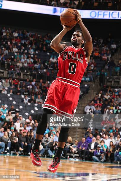 Aaron Brooks of the Chicago Bulls shoots against the Charlotte Hornets during the game at the Time Warner Cable Arena on March 13 2015 in Charlotte...