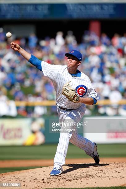 Aaron Brooks of the Chicago Cubs pitches during a game against the Oakland Athletics at Solan Park on February 25 2017 in Mesa Arizona