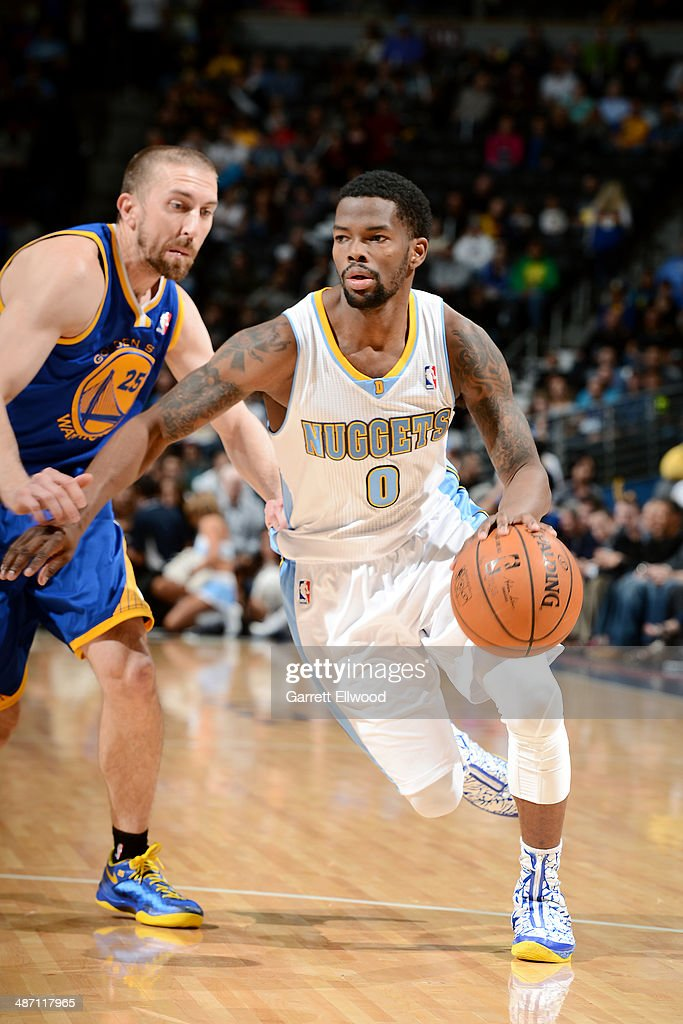 Aaron Brooks #0 of the Denver Nuggets drives against the Golden State Warriors on April 16, 2014 at the Pepsi Center in Denver, Colorado.