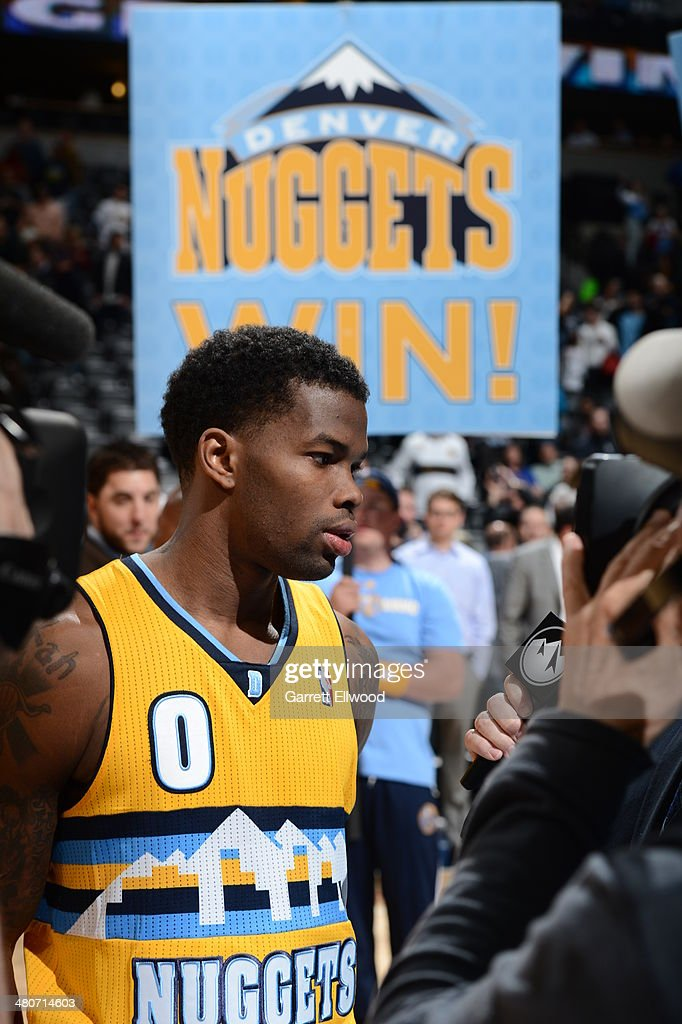 Aaron Brooks #0 of the Denver Nuggets gets interviewed after a win against the Detroit Pistons on March 19, 2014 at the Pepsi Center in Denver, Colorado.