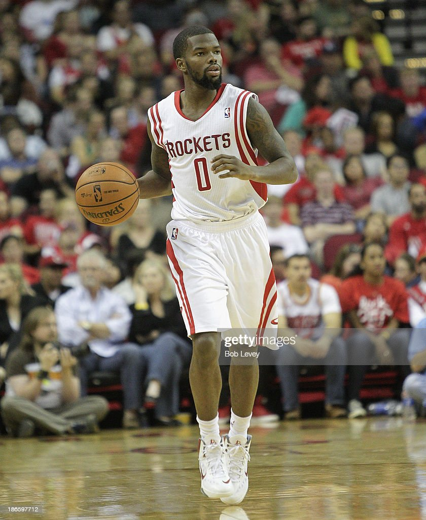 Aaron Brooks #0 of the Houston Rockets brings the ball up the court against the Dallas Mavericks at Toyota Center on November 1, 2013 in Houston, Texas.