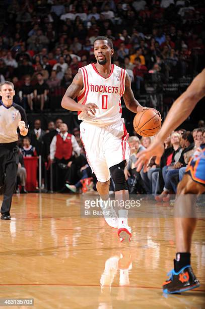 Aaron Brooks of the Houston Rockets drives against the Oklahoma City Thunder on January 16 2014 at the Toyota Center in Houston Texas NOTE TO USER...