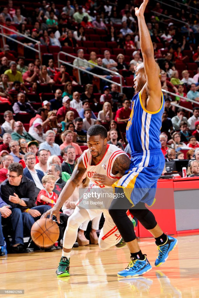 Aaron Brooks #0 of the Houston Rockets drives the ball against Jarrett Jack #2 of the Golden State Warriors on March 17, 2013 at the Toyota Center in Houston, Texas.