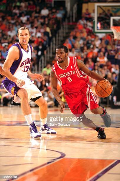 Aaron Brooks of the Houston Rockets drives the ball against Louis Amundson of the Phoenix Suns during the game at US Airways Center on April 2010 in...