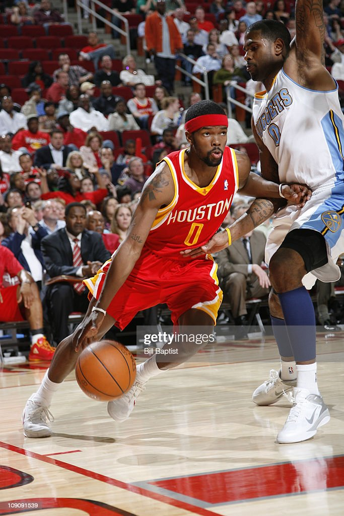 Aaron Brooks #0 of the Houston Rockets drives the ball past Gary Forbes #0 of the Denver Nuggets on February 14, 2011 at the Toyota Center in Houston, Texas.