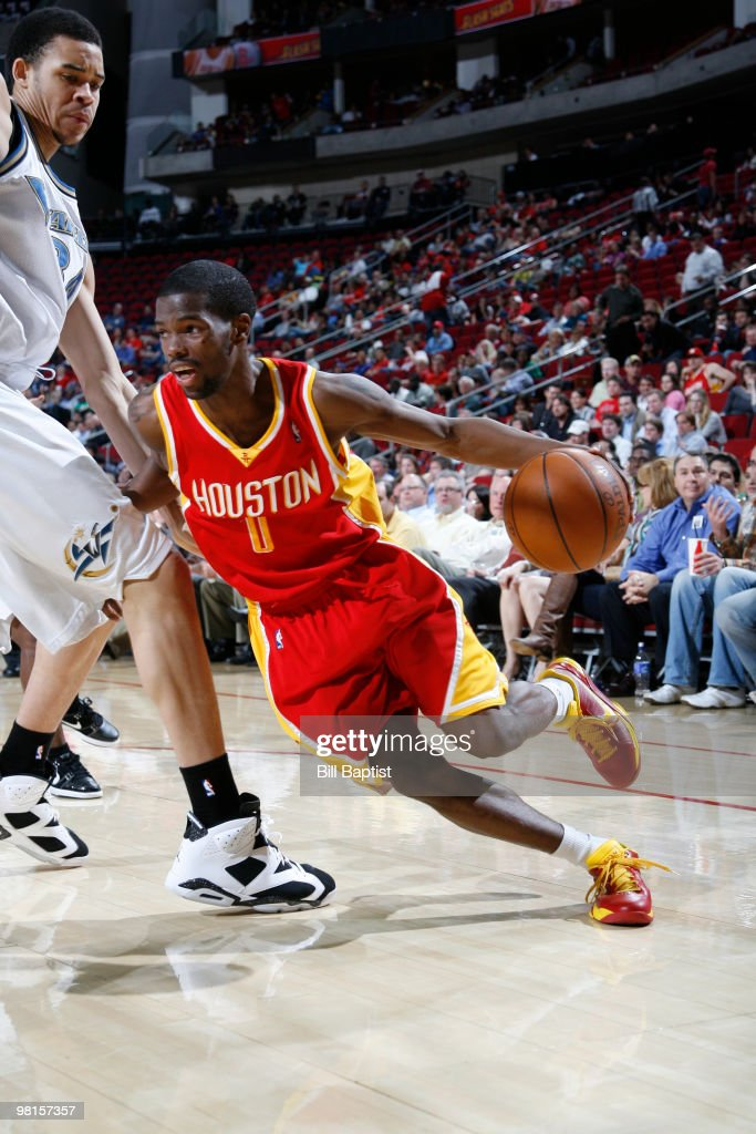 Aaron Brooks of the Houston Rockets drives the ball past JaVale McGee of the Washington Wizards on March 30 2010 at the Toyota Center in Houston...