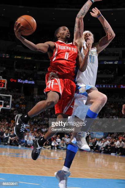 Aaron Brooks of the Houston Rockets goes to the basket against Chris Andersen of the Denver Nuggets on March 9 2009 at the Pepsi Center in Denver...