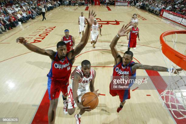 Aaron Brooks of the Houston Rockets shoots the ball over Craig Smith and Rasual Butler of the Los Angeles Clippers on March 25 2010 at the Toyota...