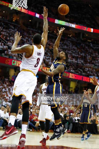Aaron Brooks of the Indiana Pacers gets off a shot over Channing Frye of the Cleveland Cavaliers during the first half in Game One of the Eastern...