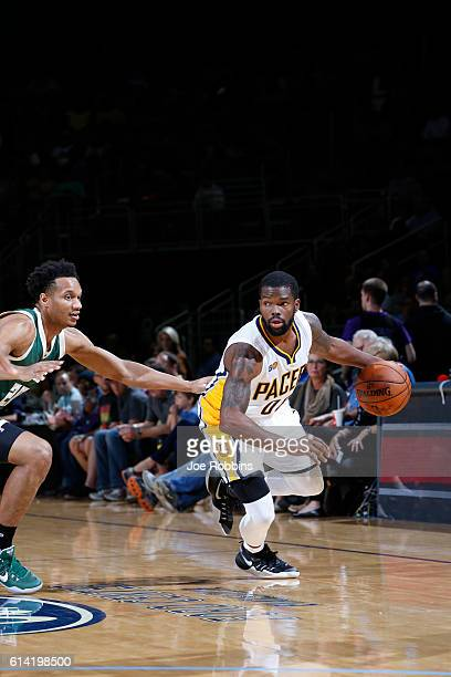 Aaron Brooks of the Indiana Pacers handles the ball against the Milwaukee Bucks during a preseason game on October 12 2016 at Ford Center in...
