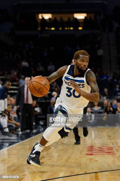 Aaron Brooks of the Minnesota Timberwolves dribbles the ball against the Indiana Pacers during the game on October 24 2017 at the Target Center in...