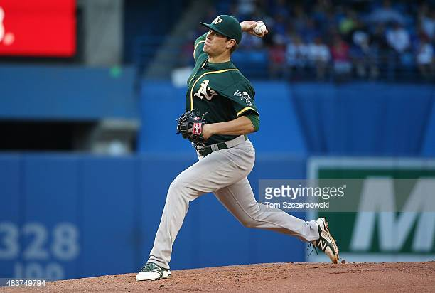 Aaron Brooks of the Oakland Athletics delivers a pitch in the first inning during MLB game action against the Toronto Blue Jays on August 12 2015 at...