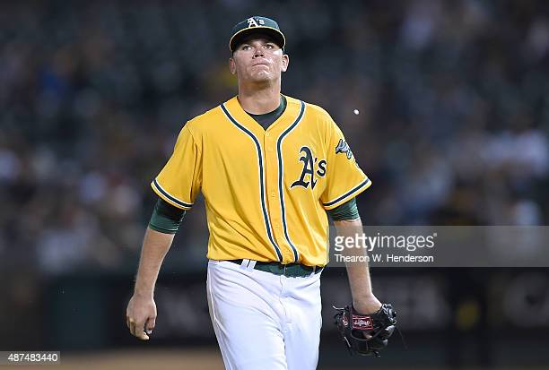 Aaron Brooks of the Oakland Athletics walks back to the dugout after being taken out of the game against the Houston Astros in the top of the fifth...