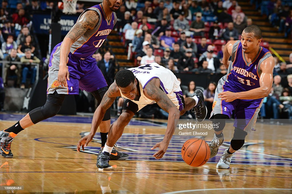 Aaron Brooks #3 of the Sacramento Kings dives for a loose ball against <a gi-track='captionPersonalityLinkClicked' href=/galleries/search?phrase=Sebastian+Telfair&family=editorial&specificpeople=202087 ng-click='$event.stopPropagation()'>Sebastian Telfair</a> #31 of the Phoenix Suns on January 23, 2013 at Sleep Train Arena in Sacramento, California.