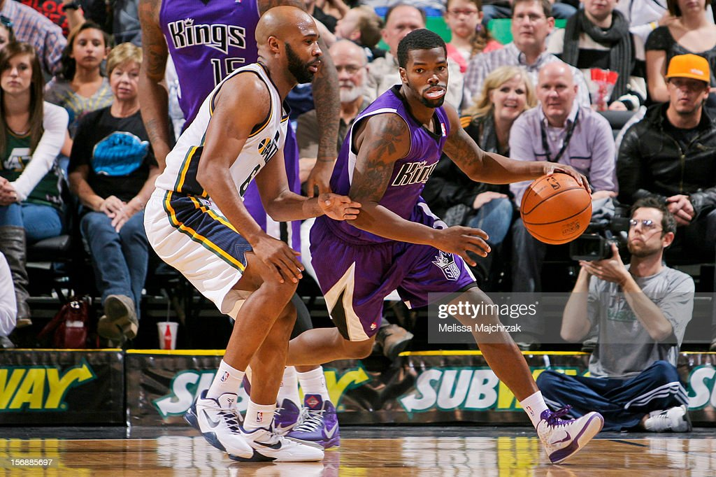Aaron Brooks #3 of the Sacramento Kings drives against <a gi-track='captionPersonalityLinkClicked' href=/galleries/search?phrase=Jamaal+Tinsley&family=editorial&specificpeople=202203 ng-click='$event.stopPropagation()'>Jamaal Tinsley</a> #6 of the Utah Jazz at Energy Solutions Arena on November 23, 2012 in Salt Lake City, Utah.
