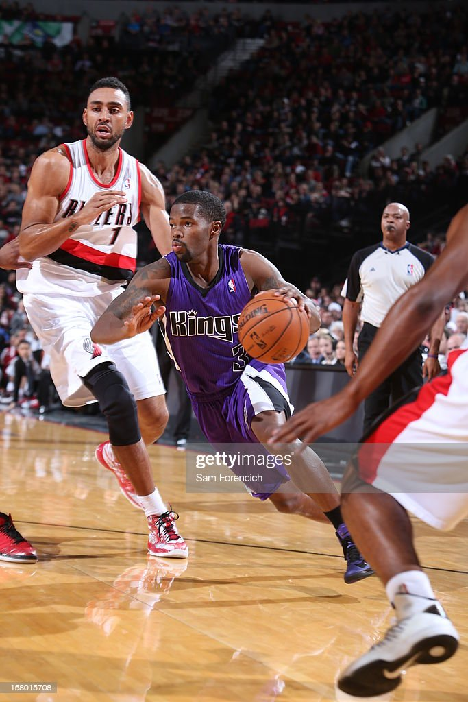 Aaron Brooks #3 of the Sacramento Kings drives against Jared Jeffries #1 of the Portland Trail Blazers during the game between the Sacramento Kings and the Portland Trail Blazers on December 8, 2012 at the Rose Garden Arena in Portland, Oregon.