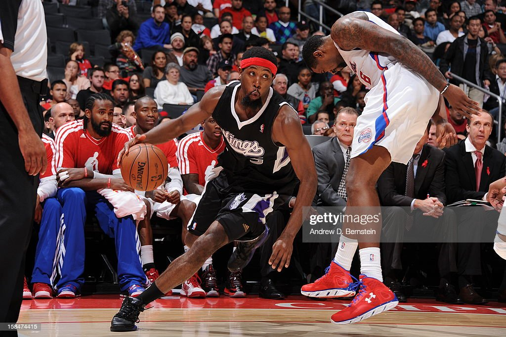 Aaron Brooks #3 of the Sacramento Kings drives to the basket around <a gi-track='captionPersonalityLinkClicked' href=/galleries/search?phrase=DeAndre+Jordan&family=editorial&specificpeople=4665718 ng-click='$event.stopPropagation()'>DeAndre Jordan</a> #6 of the Los Angeles Clippers at Staples Center on December 1, 2012 in Los Angeles, California.