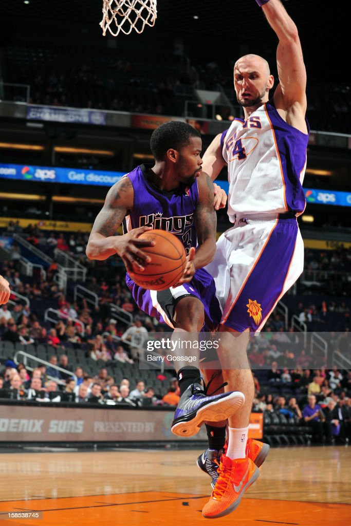 Aaron Brooks #3 of the Sacramento Kings drives to the basket around <a gi-track='captionPersonalityLinkClicked' href=/galleries/search?phrase=Marcin+Gortat&family=editorial&specificpeople=589986 ng-click='$event.stopPropagation()'>Marcin Gortat</a> #4 of the Phoenix Suns on December 17, 2012 at U.S. Airways Center in Phoenix, Arizona.