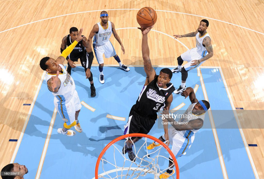 Aaron Brooks #3 of the Sacramento Kings goes to the basket against <a gi-track='captionPersonalityLinkClicked' href=/galleries/search?phrase=Ty+Lawson&family=editorial&specificpeople=4024882 ng-click='$event.stopPropagation()'>Ty Lawson</a> #3 of the Denver Nuggets during the game between the Sacramento Kings and the Denver Nuggets on January 26, 2013 at the Pepsi Center in Denver, Colorado.