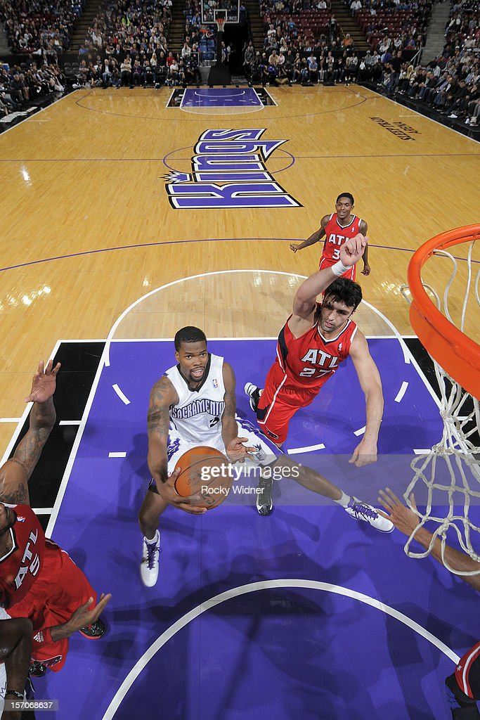 Aaron Brooks #3 of the Sacramento Kings goes up for the shot against Zaza Pachulia #27 of the Atlanta Hawks on November 16, 2012 at Sleep Train Arena in Sacramento, California.