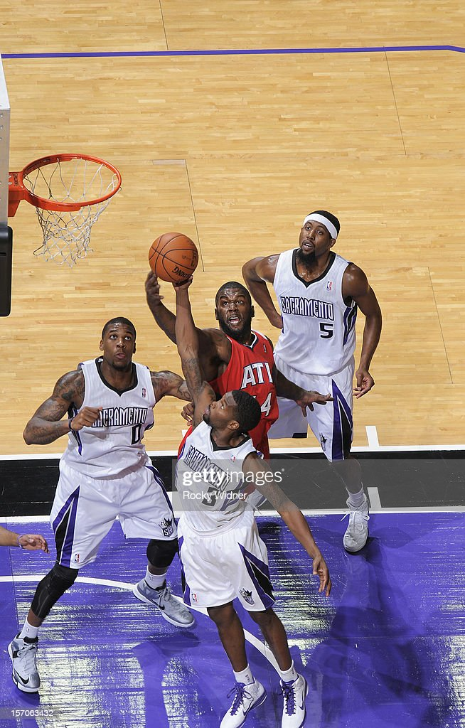Aaron Brooks #3 of the Sacramento Kings grabs the rebound away from Ivan Johnson #44 of the Atlanta Hawks on November 16, 2012 at Sleep Train Arena in Sacramento, California.