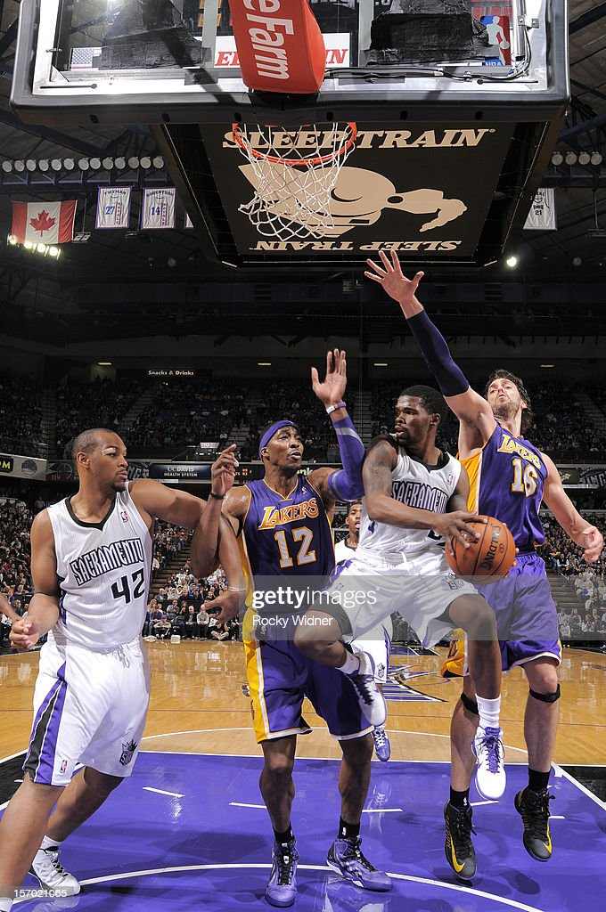 Aaron Brooks #3 of the Sacramento Kings looks to pass the ball to his teammate <a gi-track='captionPersonalityLinkClicked' href=/galleries/search?phrase=Chuck+Hayes&family=editorial&specificpeople=206129 ng-click='$event.stopPropagation()'>Chuck Hayes</a> #42 while being defended by <a gi-track='captionPersonalityLinkClicked' href=/galleries/search?phrase=Dwight+Howard&family=editorial&specificpeople=201570 ng-click='$event.stopPropagation()'>Dwight Howard</a> #12 and <a gi-track='captionPersonalityLinkClicked' href=/galleries/search?phrase=Pau+Gasol&family=editorial&specificpeople=201587 ng-click='$event.stopPropagation()'>Pau Gasol</a> #16 of the Los Angeles Lakers on November 21, 2012 at Sleep Train Arena in Sacramento, California.
