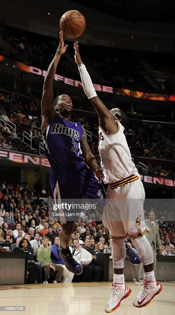Aaron Brooks #3 of the Sacramento Kings shoots against <a gi-track='captionPersonalityLinkClicked' href=/galleries/search?phrase=Kyrie+Irving&family=editorial&specificpeople=6893971 ng-click='$event.stopPropagation()'>Kyrie Irving</a> #2 of the Cleveland Cavaliers at The Quicken Loans Arena on January 2, 2013 in Cleveland, Ohio.