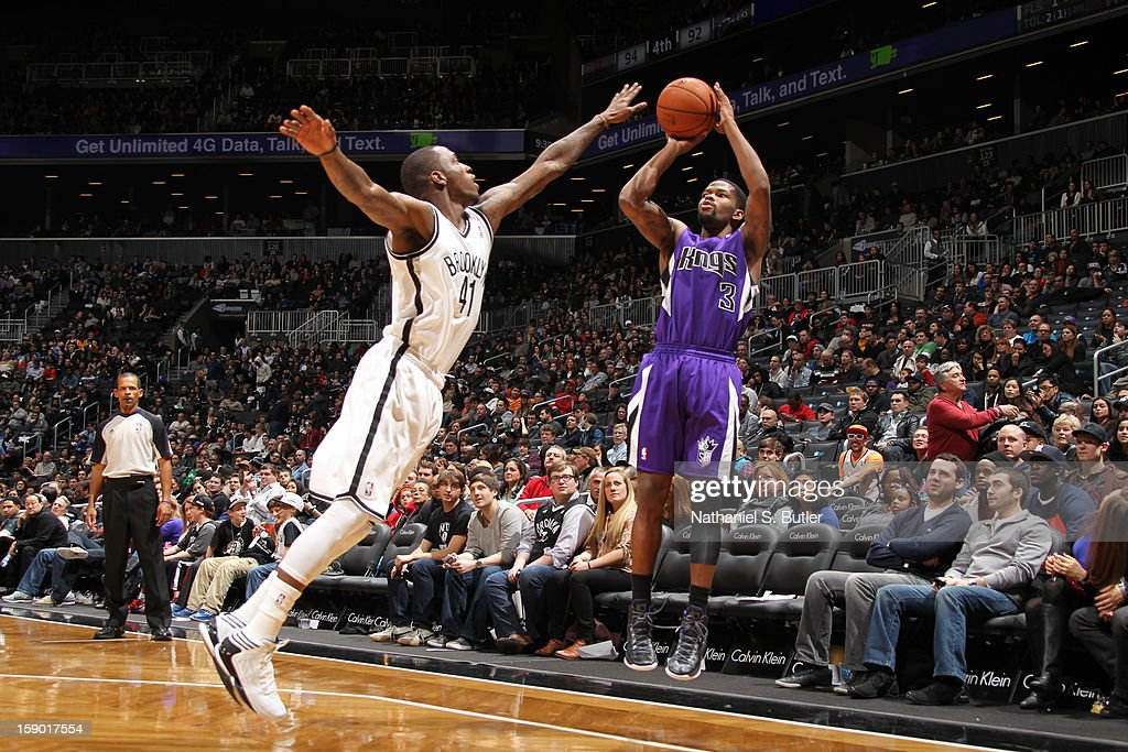 Aaron Brooks #3 of the Sacramento Kings shoots against <a gi-track='captionPersonalityLinkClicked' href=/galleries/search?phrase=Tyshawn+Taylor&family=editorial&specificpeople=5619738 ng-click='$event.stopPropagation()'>Tyshawn Taylor</a> #41 of the Brooklyn Nets on January 5, 2013 at the Barclays Center in the Brooklyn borough of New York City.