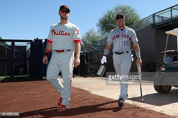 Aaron Brown and Tim Tebow of the Scottsdale Scorpions arrive to the Arizona Fall League game against the Peoria Javelinas at Peoria Stadium on...