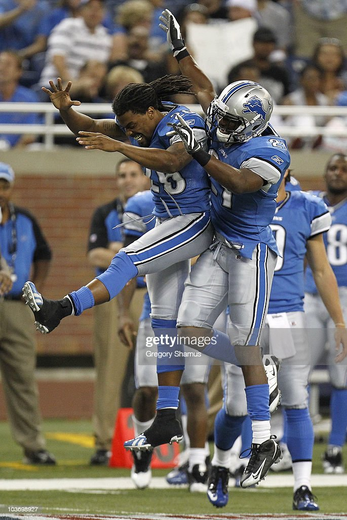 Aaron Brown #21 of the Detroit Lions celebrates his fourth quarter touchdown with Louis Delmas #26 while playing the Cleveland Browns in a preseason game on August 28, 2010 at Ford Field in Detroit, Michigan.