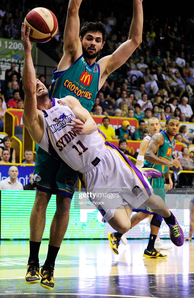 Aaron Bruce of the Kings dives to make a basket past Todd Blanchfield of the Crocodiles during the round 17 NBL match between the Townsville Crodcodiles and the Sydney Kings at Townsville Entertainment Centre on February 2, 2013 in Townsville, Australia.