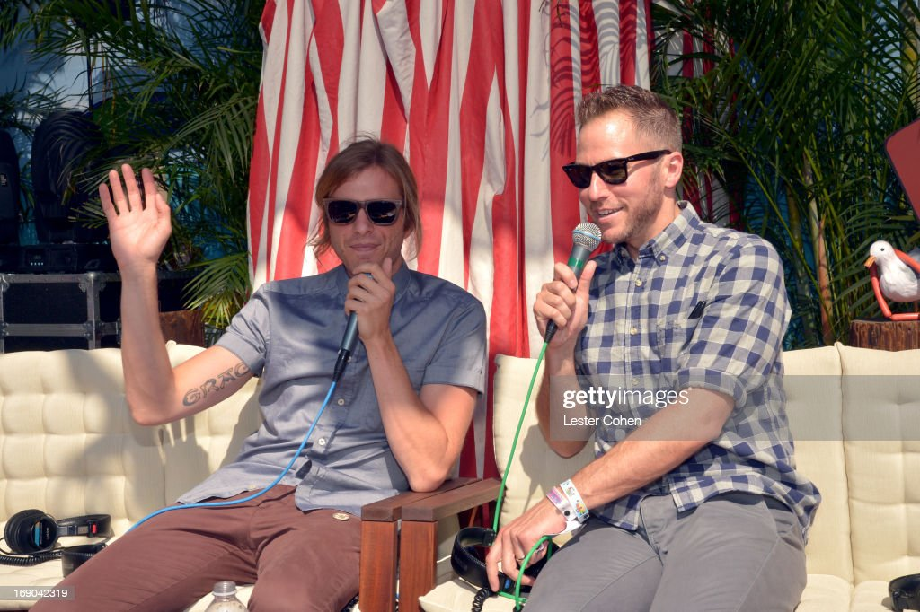 Aaron Bruno of AWOLNATION and DJ Stryker backstage during KROQ Weenie Roast Y Fiesta at Verizon Wireless Amphitheater on May 18, 2013 in Irvine, California.