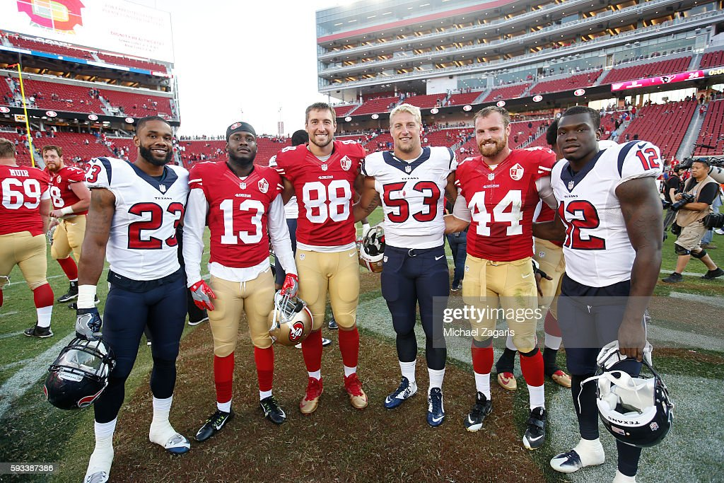 Aaron Burbridge #13, Garrett Celek #88 and Marcus Rush #44 of the San Francisco 49ers stand with Kurtis Drummond #23, Max Bullough #53 and Keith Mumphery #12 of the Houston Texans, all Michigan State alumni, on the field following the game at Levi Stadium on August 14, 2016 in Santa Clara, California. The Texans defeated the 49ers 24-13.