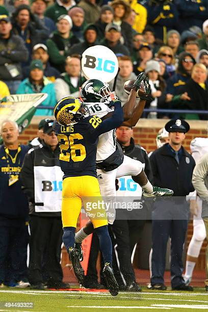 Aaron Burbridge of the Michigan State Spartans attempts to make a catch in the fourth quarter against Jourdan Lewis of the Michigan Wolverines at...