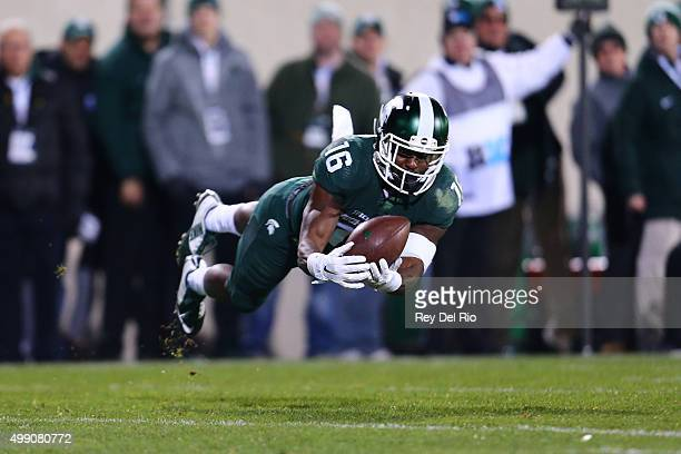 Aaron Burbridge of the Michigan State Spartans attempts to make a catch in the fourth quarter against the Penn State Nittany Lions at Spartan Stadium...