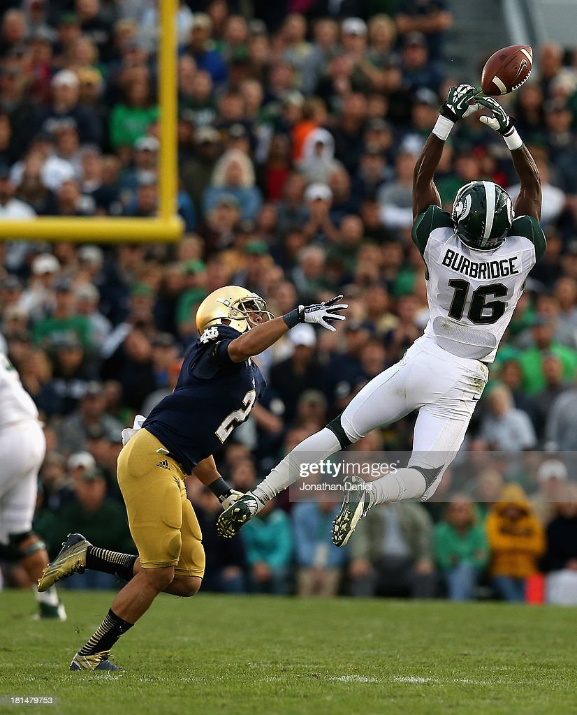 Aaron Burbridge #16 of the Michigan State Spartans leaps in vain for a pass as Bennett Jackson #2 of the Notre Dame Fighting irish defends at Notre Dame Stadium on September 21, 2013 in South Bend, Indiana. Notre Dame defeated Michigan State 17-13.